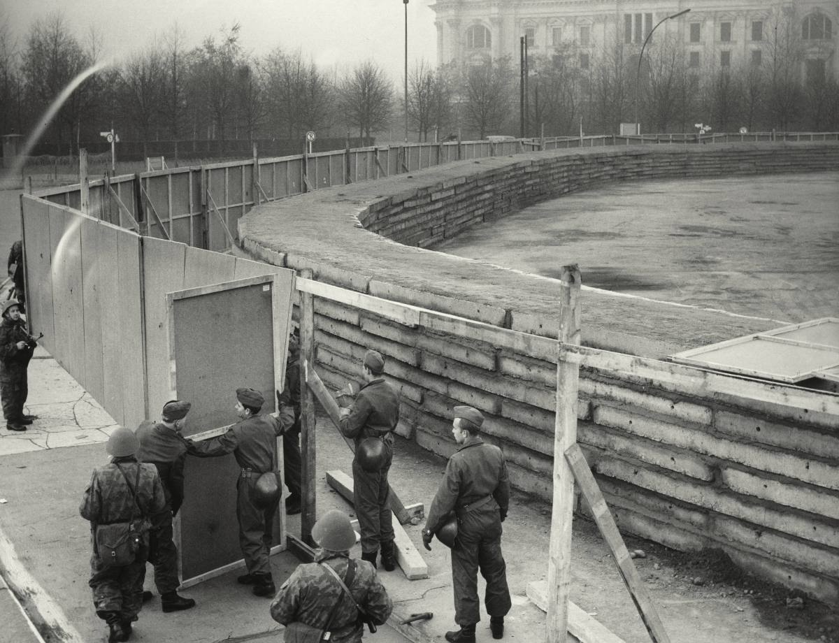 Why did the GDR build the Berlin Wall?