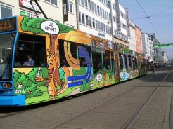 Trams add a splash of colour to an uninspiring cityscape