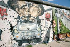 Trabi through wall Mural East Side Gallery Berlin