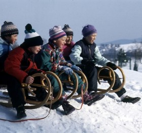 Tobogganing kids on the Fichtelberg
