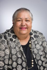 Photographed in a headshot style photo, looking into the camera, USC Gerontology alumna Laura Trejo '82, MSG/MPA '86 is general manager for the City of Los Angeles Department of Aging.
