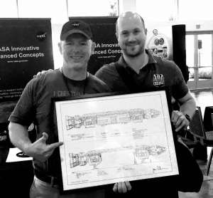 Troy and Jamie with his Space:1999 Eagle blueprints at NASA.
