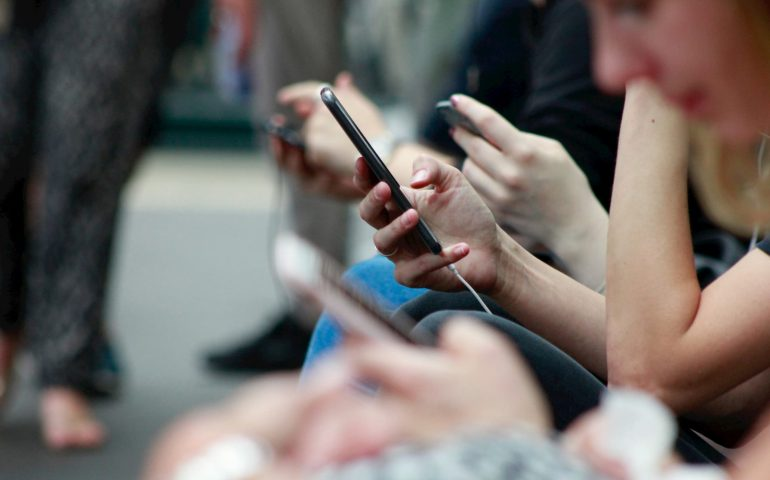 captioning - transcription - subtitles - people on their phones