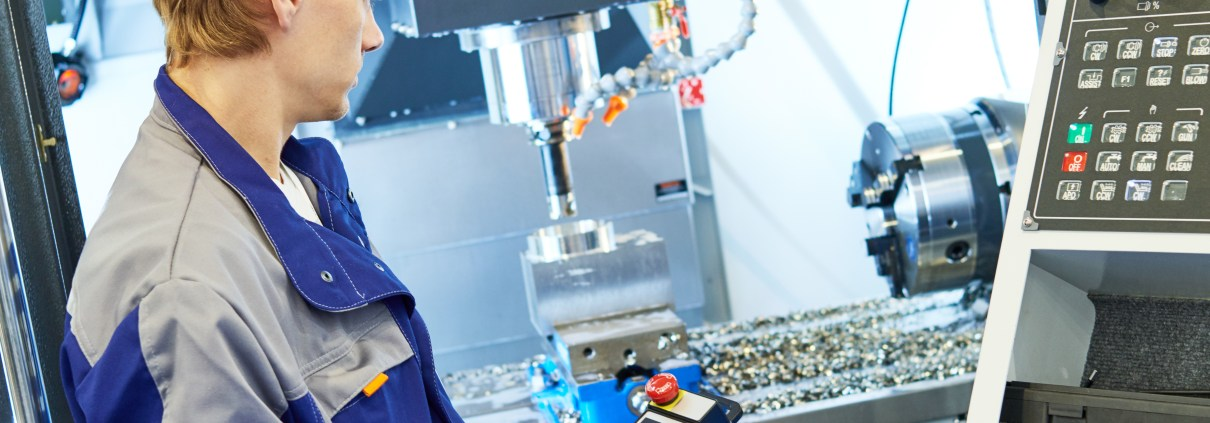 machinist operating a cnc machine in factory freepoint technologies