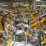 oee machine technology blog header freepoint technologies factory robotic arms manufacturing