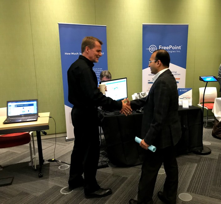 freepoint technologies greeting customers trade show booth president