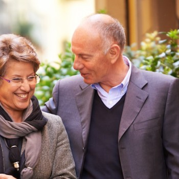 photo of baby boomer couple with shopping bags