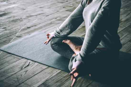 woman sitting in calm yoga pose