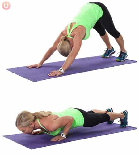 Chris Freytag demonstrating Downward Dog Push up in a green tank top on a purple yoga mat