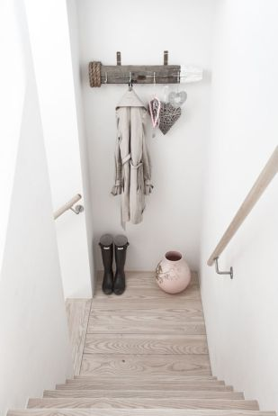 Reclaimed wood transformed into an entryway coat rack.