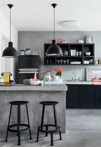 Design distinct sections throughout your kitchen by placing hanging lights near the spaces you'd like to highlight.