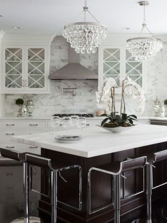 For extra charm, suspend miniature chandeliers over island tops to create an exquisite sparkle when in use.