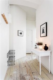 he hovering shelve and wooden wall hook complete this minimal household.
