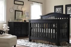 A classy palette of white and beige makes a striking background for this elegant black crib.
