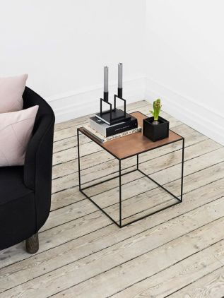 A black side table with a copper cover.