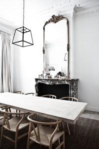 A minimal dining set creates balance between a busy room.