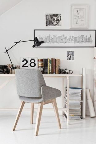 The books, magazines and artwork add more interest to the simple table and chair set.