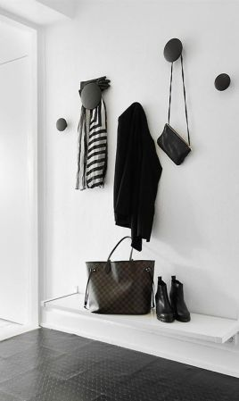 Get creative with how you hang your guest's belongings.