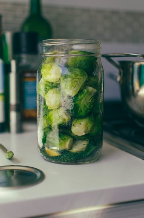 Prepared Brussel sprouts in a jar ready for pickling juices - The Mummy