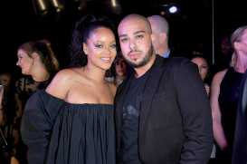 PARIS, FRANCE - SEPTEMBER 21: Rihanna poses with lead makeup artist Hector from the Sephora pro team during the Fenty Beauty By Rihanna Paris Launch Party hosted by Sephora at Jardin des Tuileries on September 21, 2017 in Paris, France. (Photo by Dominique Charriau/Getty Images for Fenty Beauty) *** Local Caption *** Rihanna