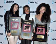 Ashley Calhoun, Ericka Coulter and KIRBY with their awards