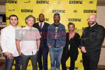 """AUSTIN, TX - MARCH 17: Chris Lopez and directors Gabriel Noble, Marcus A. Clarke, Sacha Jenkins, Geeta Gandbhir and Ben Selkow attend the red carpet premiere of """"Rapture"""" during SXSW 2018 at Paramount Theatre on March 17, 2018 in Austin, Texas. (Photo by Daniel Boczarski/Getty Images for Netflix) *** Local Caption *** Chris Lopez;Gabriel Noble;Marcus A. Clarke;Sacha Jenkins;Geeta Gandbhir;Ben Selkow"""