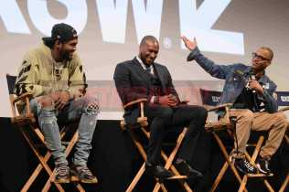 """AUSTIN, TX - MARCH 17: Dave East, director Marcus A. Clarke and T.I. attend a Q&A following the premiere of """"Rapture"""" during SXSW 2018 on March 17, 2018 in Austin, Texas. (Photo by Daniel Boczarski/Getty Images for Netflix) *** Local Caption *** Dave East;Marcus A. Clarke;T.I."""