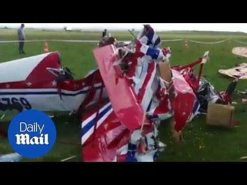 Footage shows wreckage after deadly midair crash in Romania airshow - Daily Mail