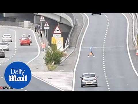 Shopaholic motorists have to dodge 70mph cars as road reopens - Daily Mail