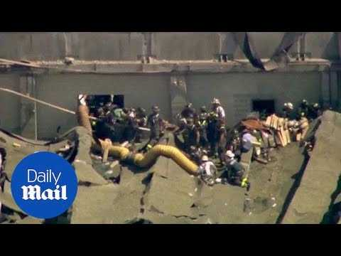 Aerial footage of firefighters rescuing people from plant explosion