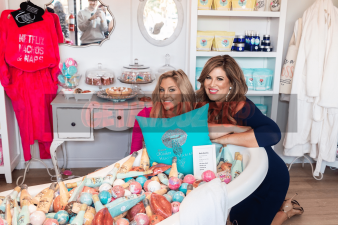 Gina Kirschenheiteer and Emily Simpson get cozy wearing bath robes while shopping for at home spa products at Beauty Kitchen Boutique