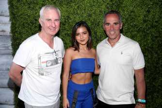 COACHELLA, CALIFORNIA - APRIL 14: Isabela Moner (C), Monte Lipman (R) and guest attend Republic Records Celebrates Their Class Of 2019 In Coachella Valley at Zenyara on April 14, 2019 in Coachella, California. (Photo by Randy Shropshire/Getty Images for Republic Records)