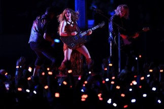 Shakira performs with her Gibson Firebird guitar during the Pepsi Superbowl LIV Halftime Show at Hard Rock Stadium.