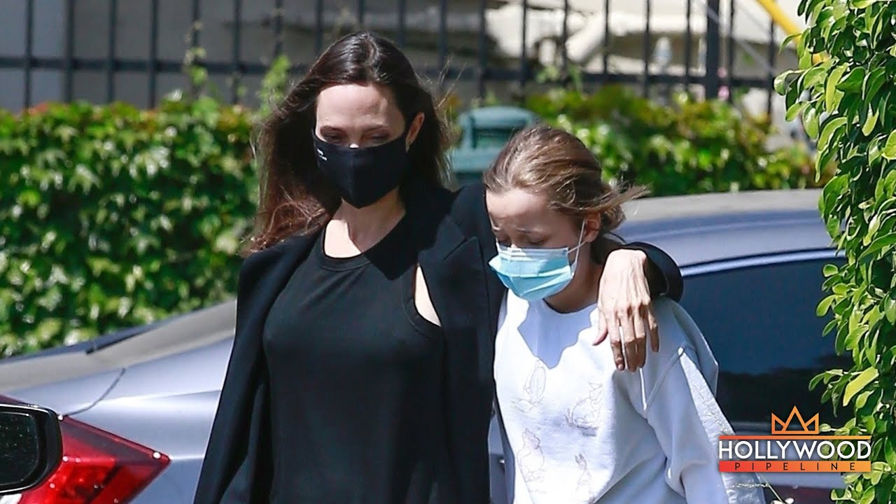 Angelina Jolie walking arm-in-arm with Vivienne Jolie-Pitt at flower shop in Los Angeles