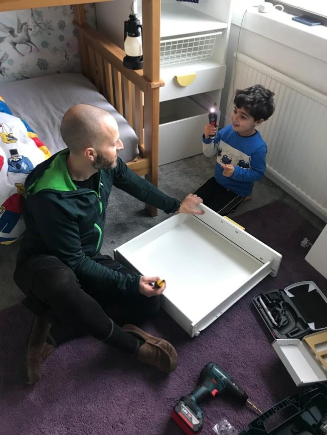 Sam and I building furniture on the carpet in the bedroom.