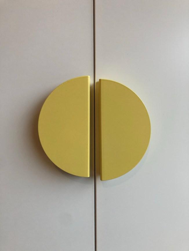 Door handles on cupboard doors slightly misaligned with one another.