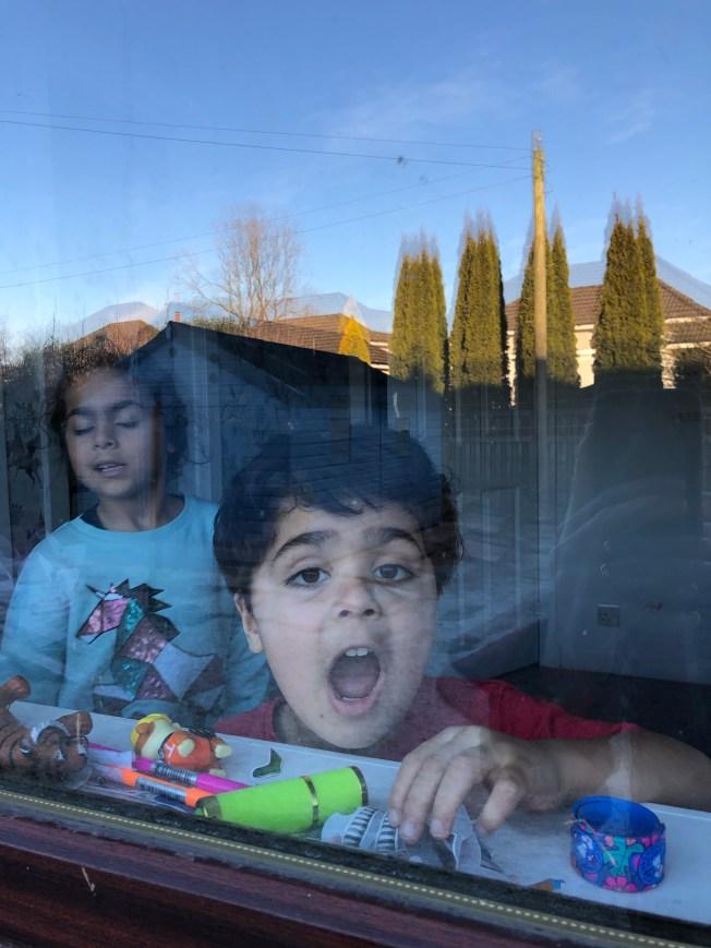 Kids watching me work through the bedroom window.