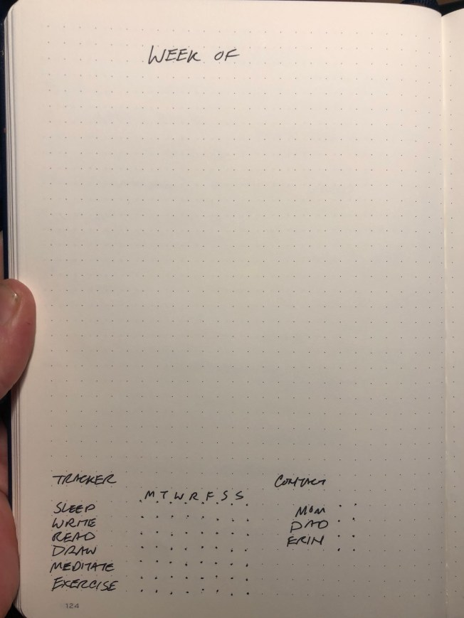 Weekly entry template in notebook.