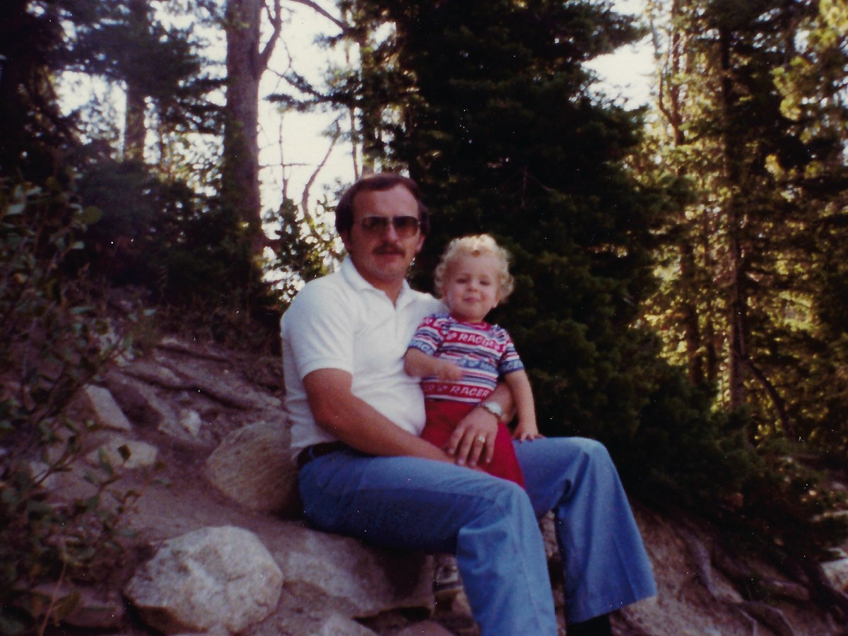 My dad and I sitting on a rock at Yellowstone park.
