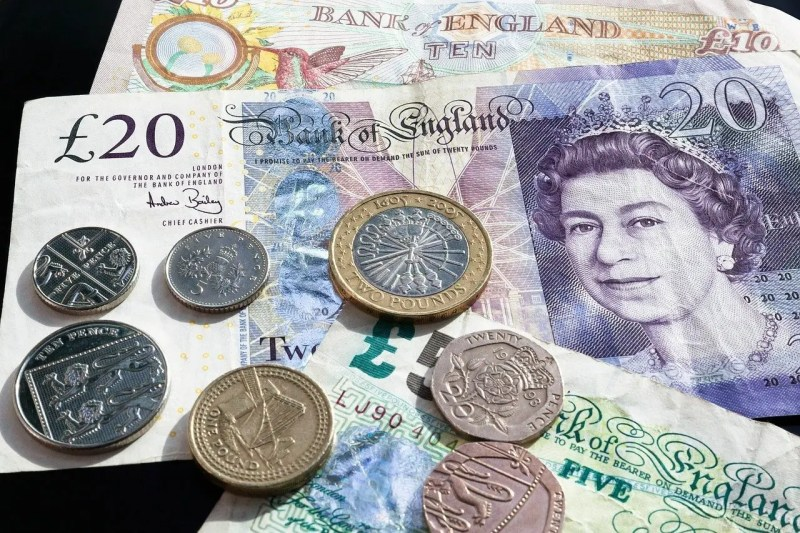 Pound notes and coins.