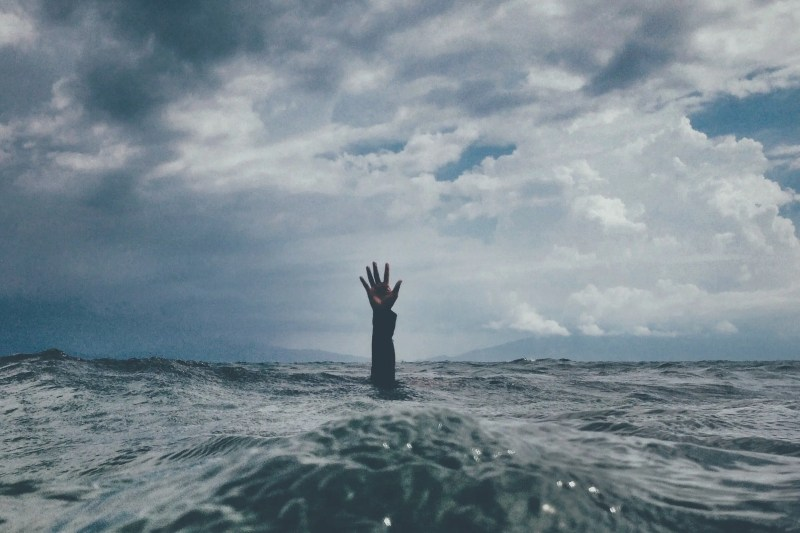hand rising up out of the water