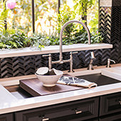 This silver and black herringbone backsplash reflects the light