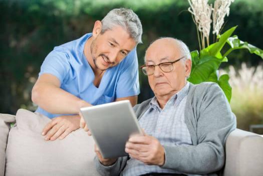 Caretaker Elder on Tablet - Rural Hospital Closures: How Telemedicine Could Provide Relief