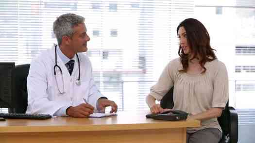 A doctor talking with a patient - Creating a Broader Understanding of Health and Healthcare Services