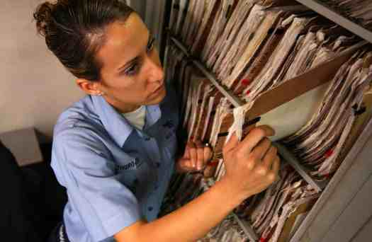 US Navy 041019 N 5821P 019 Airman Lauren Thurgood of Las Vegas2C Nev.2C pulls patient medical records in the inpatient ward aboard the conventionally powered aircraft carrier USS Kitty Hawk - A Guide to Testing Electronic Health Record Systems