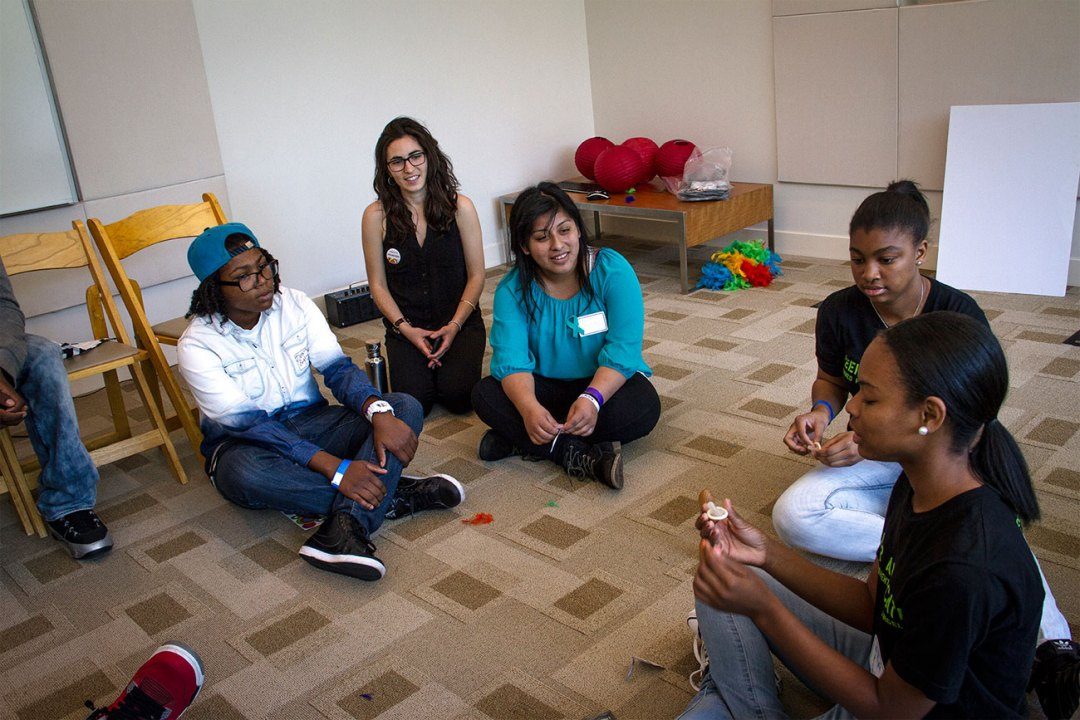 Group of young women of color talking about sexual health