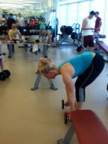 Now, grab your dumbbells and perform a row to extension.