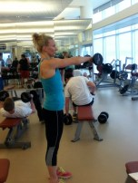 Now, at the top of the dumbbell curl go ahead and perform a slow and controlled crossover punch on both sides.