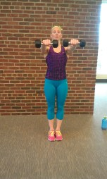 Contract and lift the weights to shoulder height.