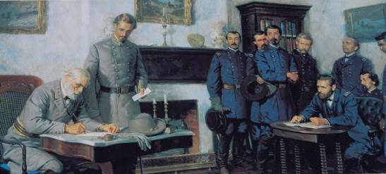 Lee and Grant meet at Appomattox Court House to settle terms of surrender. Wikimedia Commons.